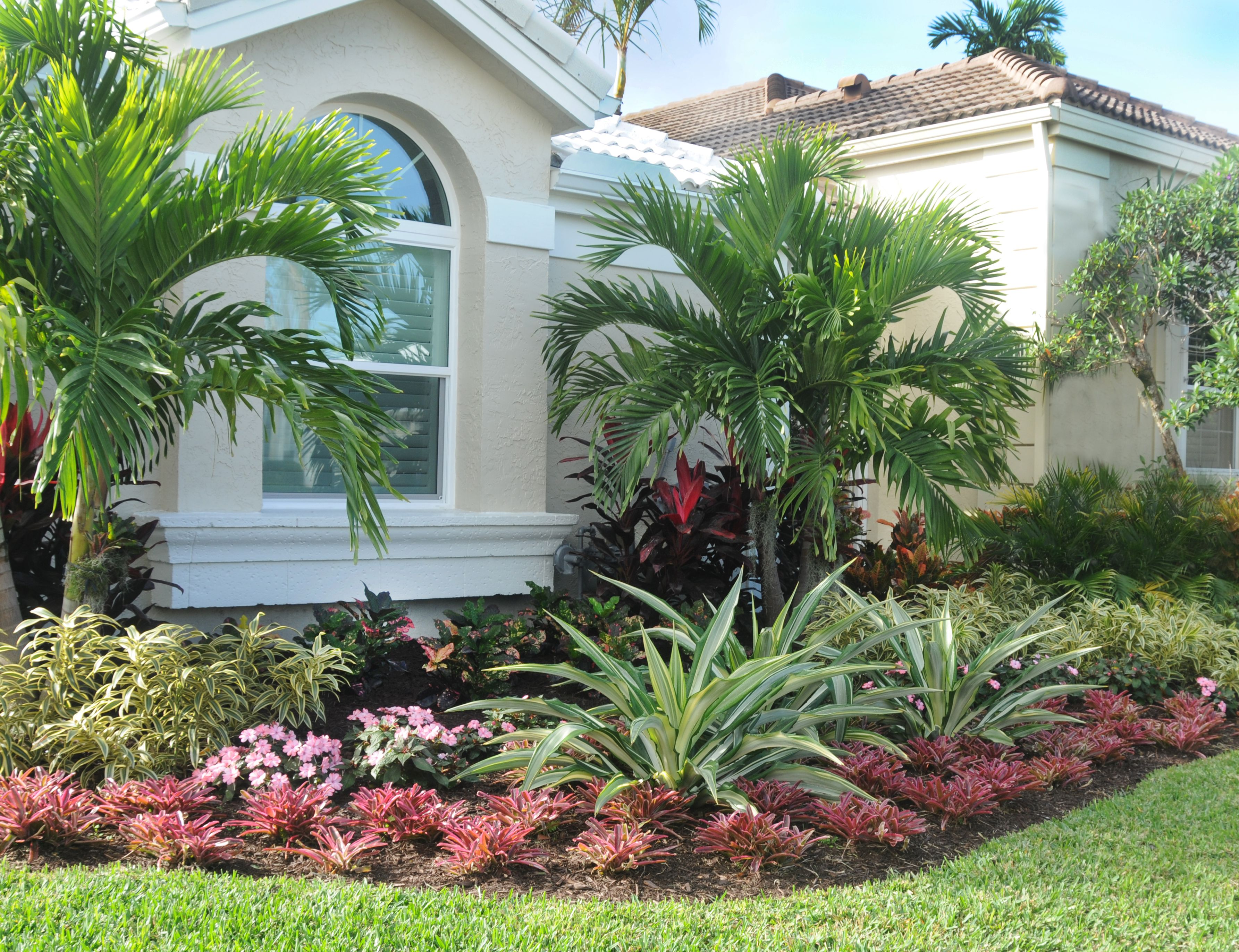 Palms And Tropical Color Form This Landscape In The Ballenisles Community  In Palm Beach Gardens,