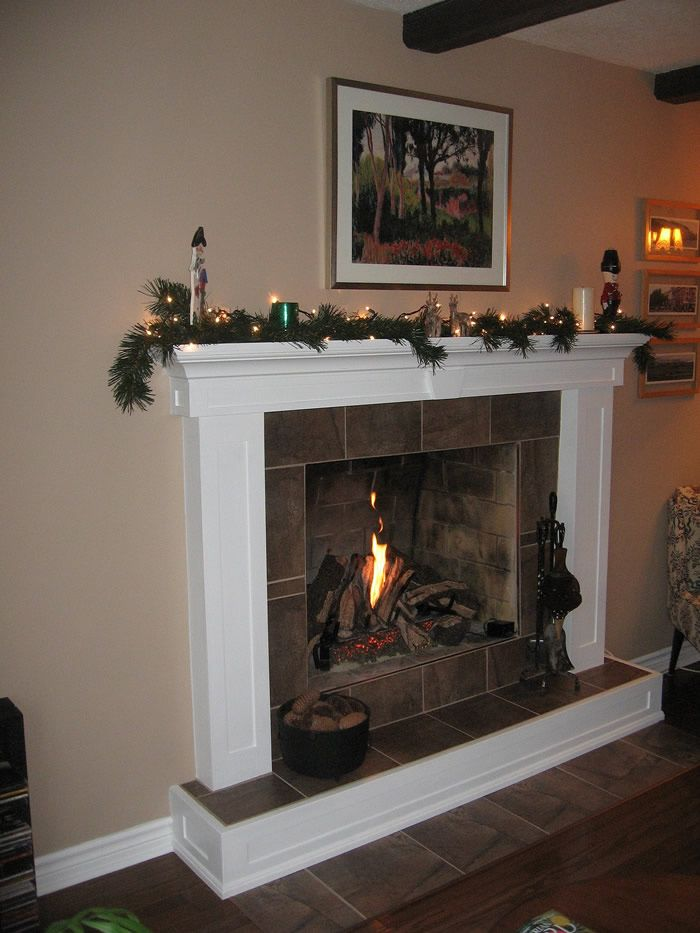 Gas Fireplace With Granite Surround And Barn Beam Mantle By