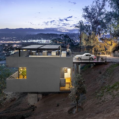 modern house on stilts steep slope architecture building future