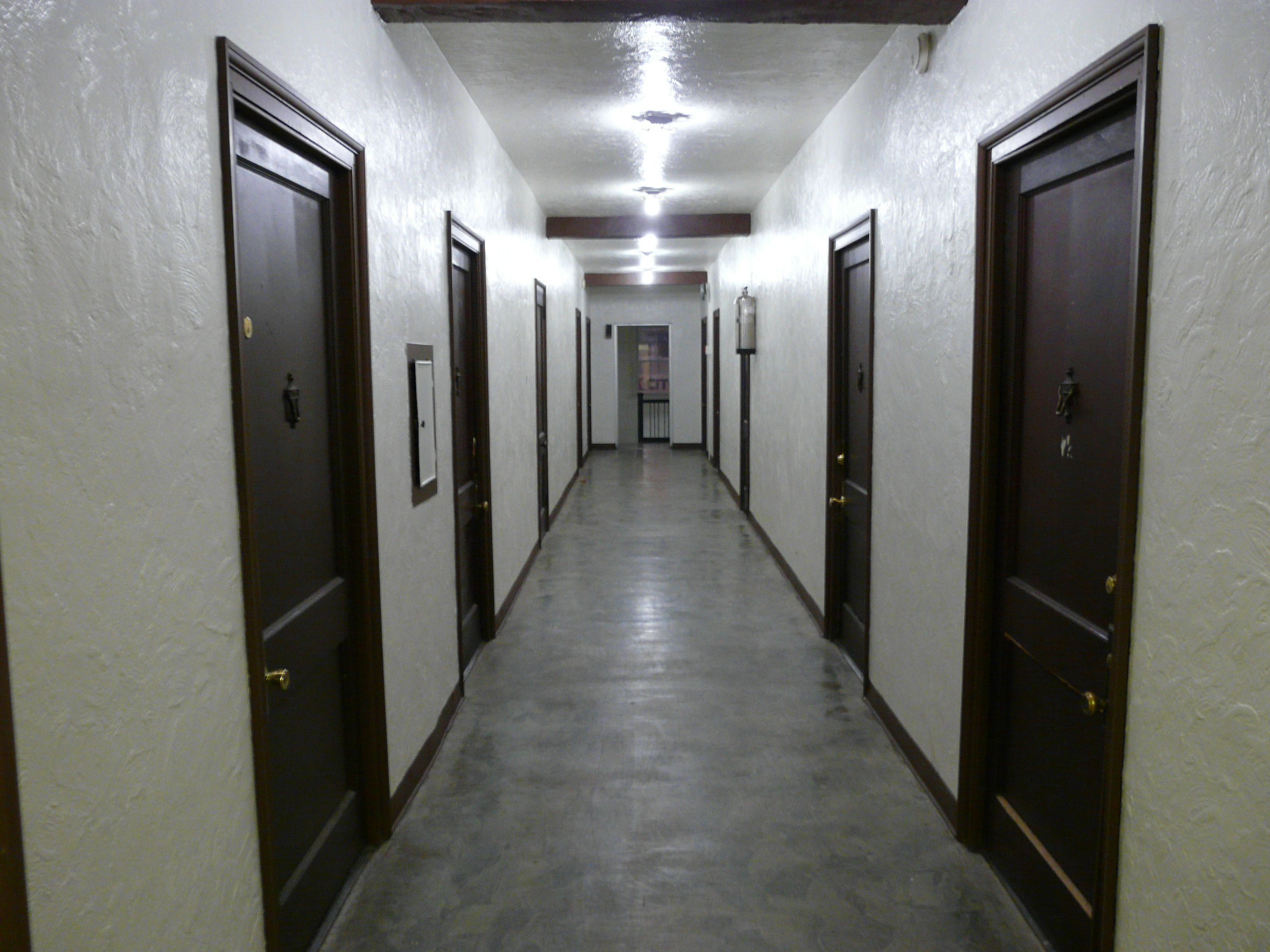 Corridor A Passage Into Which Several Rooms Or Apartments