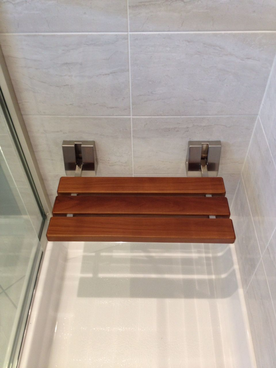 Fold down shower seat. Want this!! But, want mounted higher with eye ...