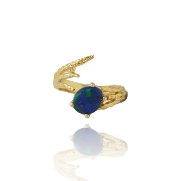 Made in Chrysocolla from Arizona, USA, the Earth ring is a celebration and reminder of our beautiful home planet. The ring is designed to curate a look of natural beauty and love of our home, using of Chrysocolla that has the look of earth in its very natural format. The white Topaz adds a touch of sophistication and romance like a shooting star next to the centre stone. Together with the designer's signature textured surface on ring band in shiny yellow gold plated sterling silver, the ring…