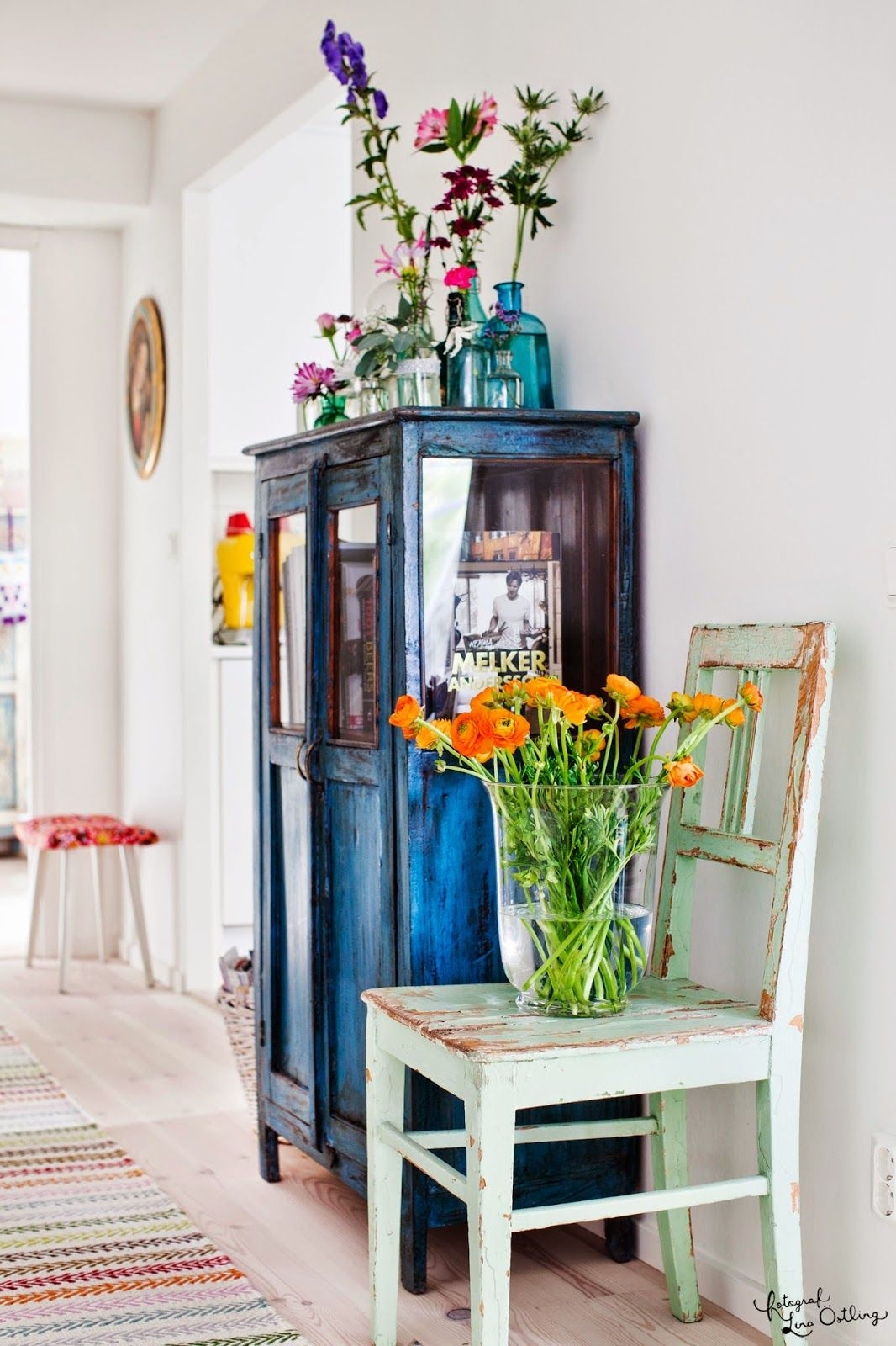 Wooden furniture and freshly picked flowers.