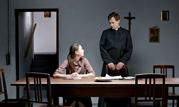 Lea van Acken as Maria and Florian Stetter as a charismatic priest in Stations of the Cross.