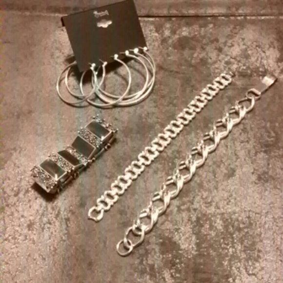 Silvertone hoop earrings, Two silvertone braclets, one blue stretch braclet, at a bundle price. Jewelry Bracelets