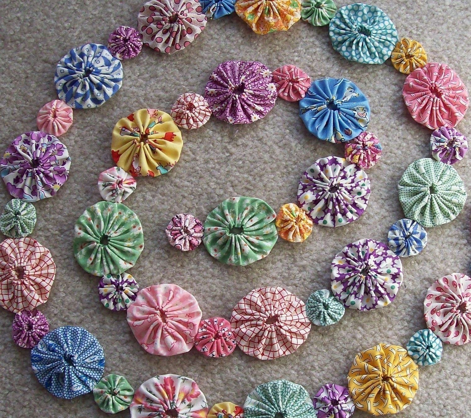 Fabric yo yo garland! My mom has always made these into quilts!