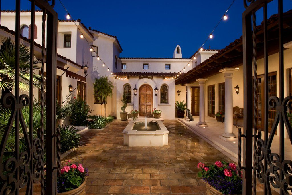Hacienda style homes courtyard with wrought iron gate in Hacienda house plans with courtyard