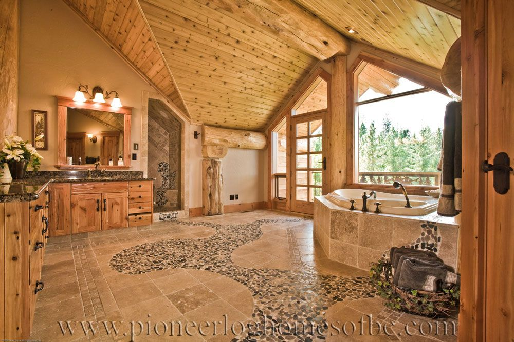 log influences on interior of master bath round log post and beam home - Bathroom Ideas Log Homes
