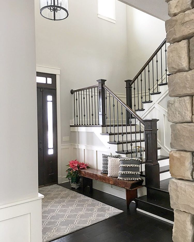 Neutral modern farmhouse foyer with wainscoting stained for Foyer staircase decorating ideas