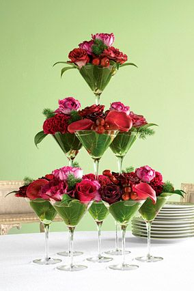 Martini glasses made into a floral tower. Cute!