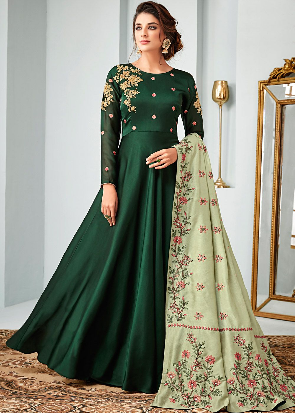 ce5184c0d0599 Featuring a green georgette satin flared kameez crafted with minimal zari  embroidery and stone work.