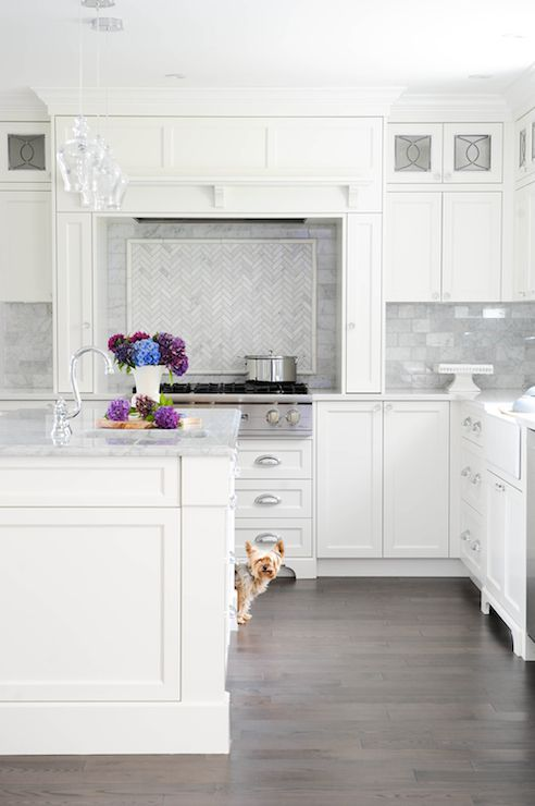 white shaker cabinets with quartz countertops. enviable designs - fabulous kitchen features shaker cabinets paired with white quartz countertops and carrera marble a