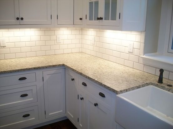 granite counter, white cabinets, subway tile, under cabinet lighting ...