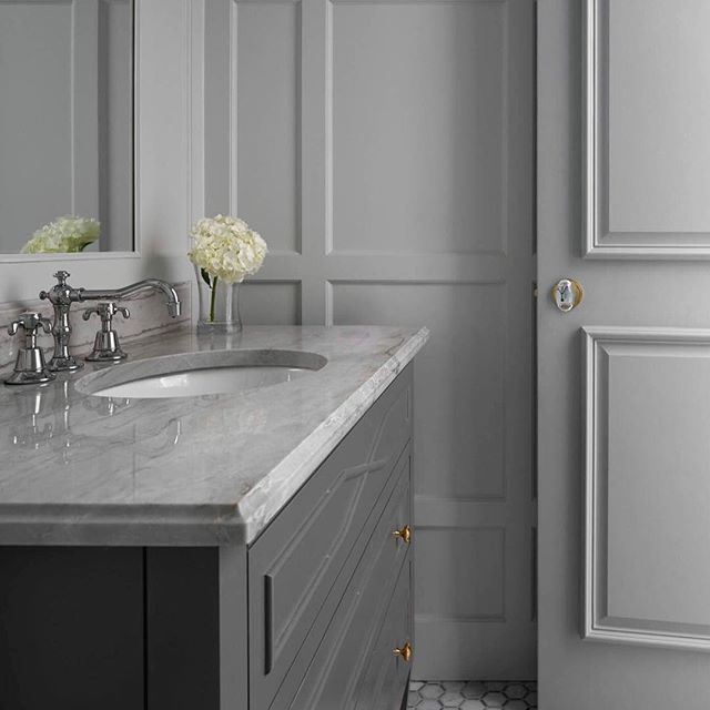 Gray Powder Bath With Marble Counters Design By Jenkins Interiors