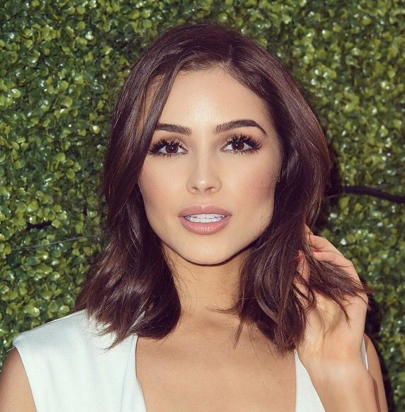 Olivia Culpo pairs her perfect brows with long lashes, a nude lip, and bronzed cheeks and the result is stunning