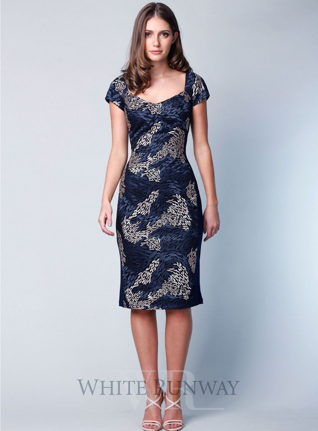 8dc7c1699755 Victoria Dress. A lovely midi length dress by Jesse Harper. A soft  v-neckline style featuring short sleeves and beautiful print design.