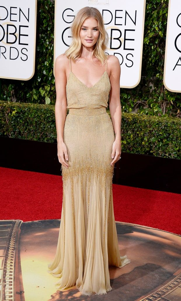 Rosie Huntington- Whiteley went nude in a flesh-colored, spaghetti-strap dress, dripping with beads by VERSACE (dazzling gold embellished gown).