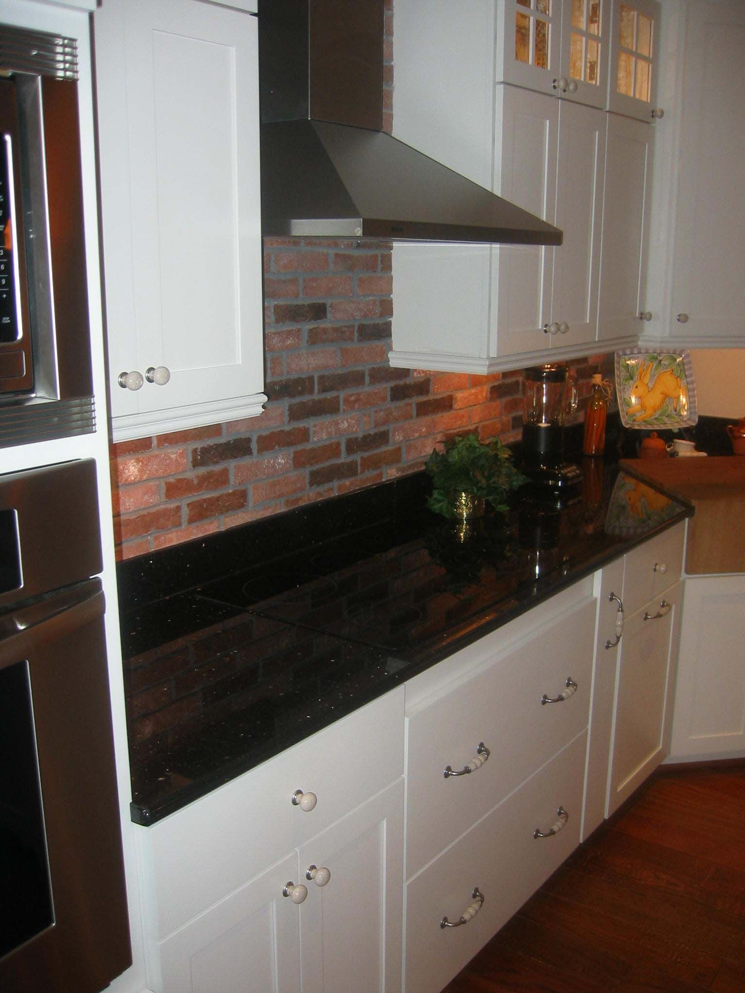 Brick tile kitchen back splash with extra black and white in the brick tile kitchen back splash with extra black and white in the color mix or dailygadgetfo Images