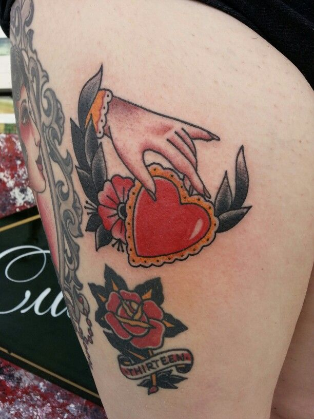 traditional hand holding heart valentine tattoo by steve