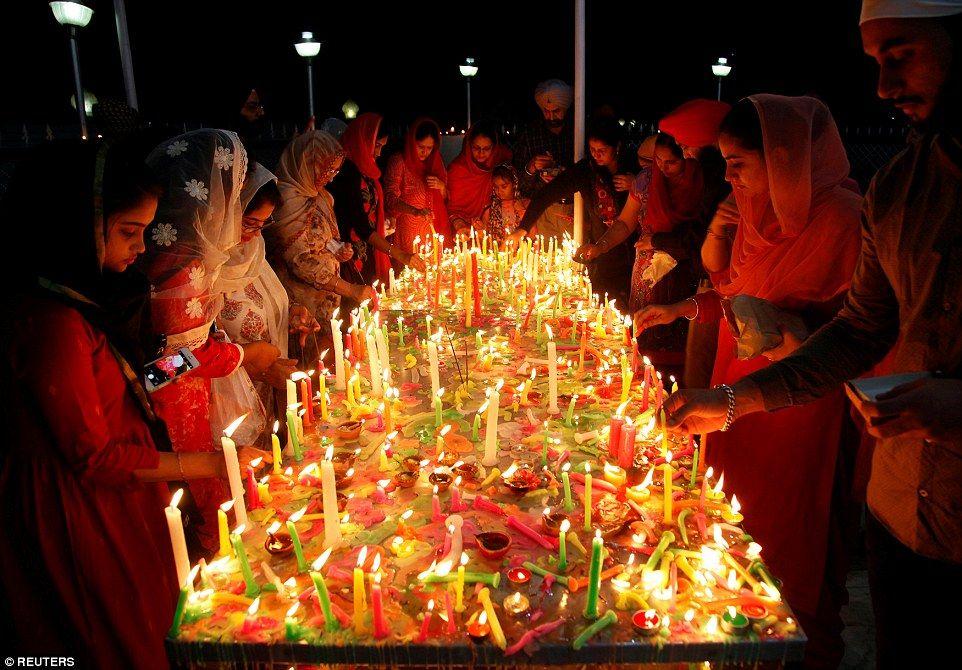 Devotees at a Gurdwara, or Sikh temple, during celebrations to mark Bandi Chhorh Divas on ...