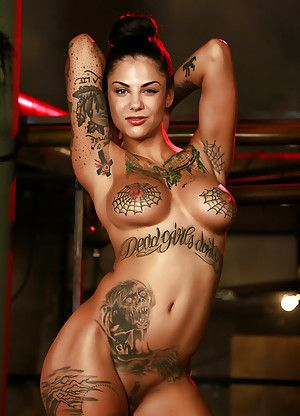 Bonnie Rotten Nude With Hands In The Air Showing Tattooed Tits