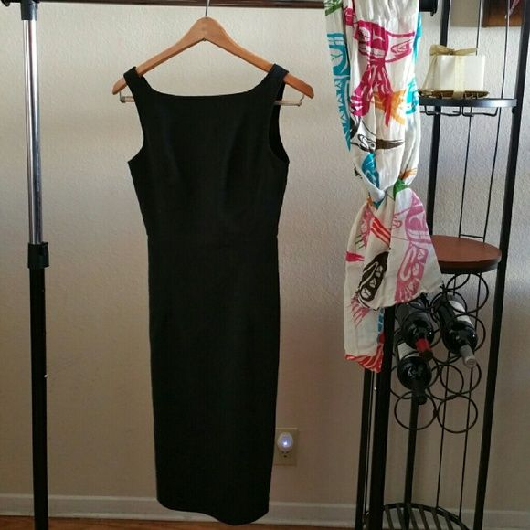 """Classic black dress. Semi body hugger. From Express Stretch collection. 8-inch side slits. Relaxed, dress is 36"""" front length, 30"""" back length, and 14"""" armpit-to-armpit. Material is rayon/nylon/lycra/spandex. Labeled size says 3-4. Express Dresses Midi"""