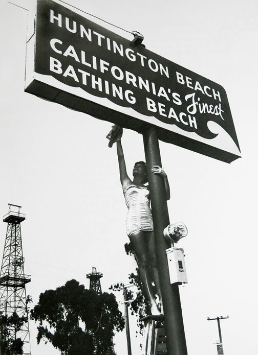 A Model Lighting The Sign Huntington Beach California S Finest Bathing