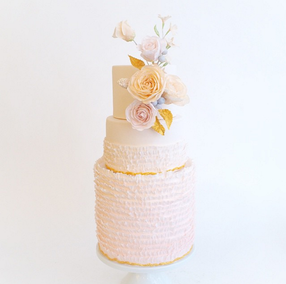 Blush Tiered Wedding Cake With Peach And Pink Sugar Flowers