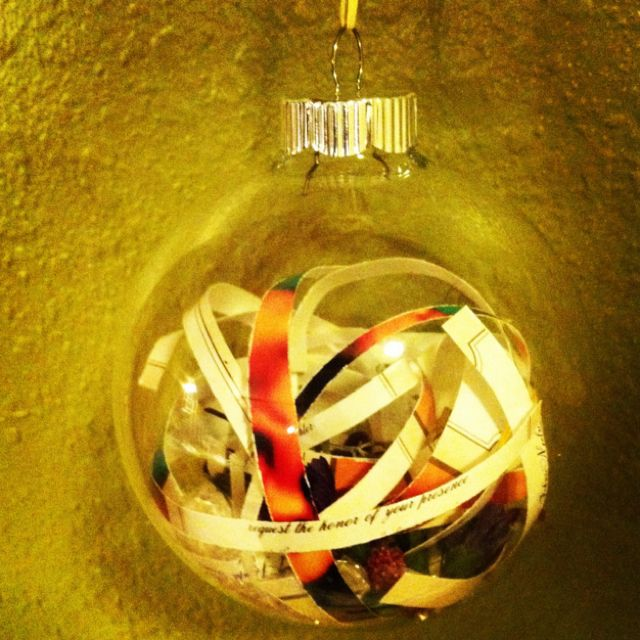 Christmas ornament made out of things from our wedding, invitations, flowers, beads etc.. Love it! So cute and makes a great keep sake! :)