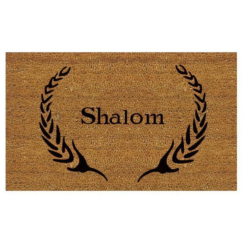 Create a warm welcome for your guests with this inspiring Shalom doormat. Made of natural coir with a vinyl backing to prevent movement, this durable mat is made to withstand traffic and is a perfect addition to any porch or patio area.