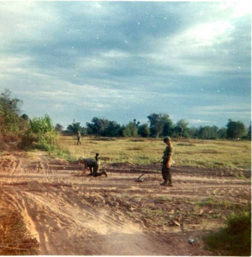 Soldiers of the 65th Engineer Battalion sweeping for mines, circa 1968.