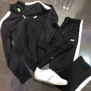 ✨New Arrival✨ Boss Green tracksuit, black with white stripe detail and Boss  Green white trainers with Hugo Boss logo and stripes.