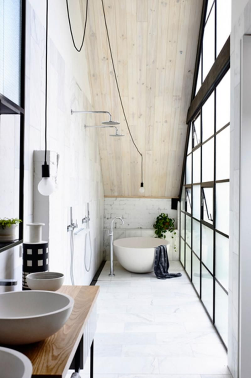 An unmistakably industrial feeling combines with natural timber and smooth curves to ensure the small bathroom space is welcoming. #bath #minimal