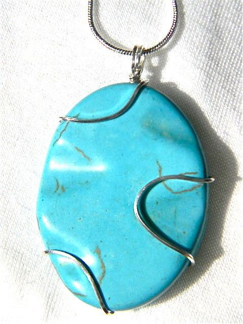 "Oval shaped Turquoise large stone necklace is silver wire wrapped accenting the unique caverns in the stone on 16"" Sterling Silver chain. $30.00  It can be seen at http://www.miselaynesjewels.weebly.com as well as my other jewelry creations."