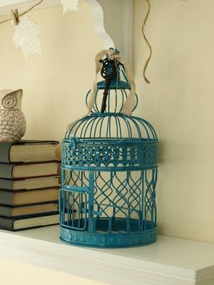 I want something like this for my baby's room!!!  If anyone sees a decorative birdcage at a reasonable price, let me know! :)