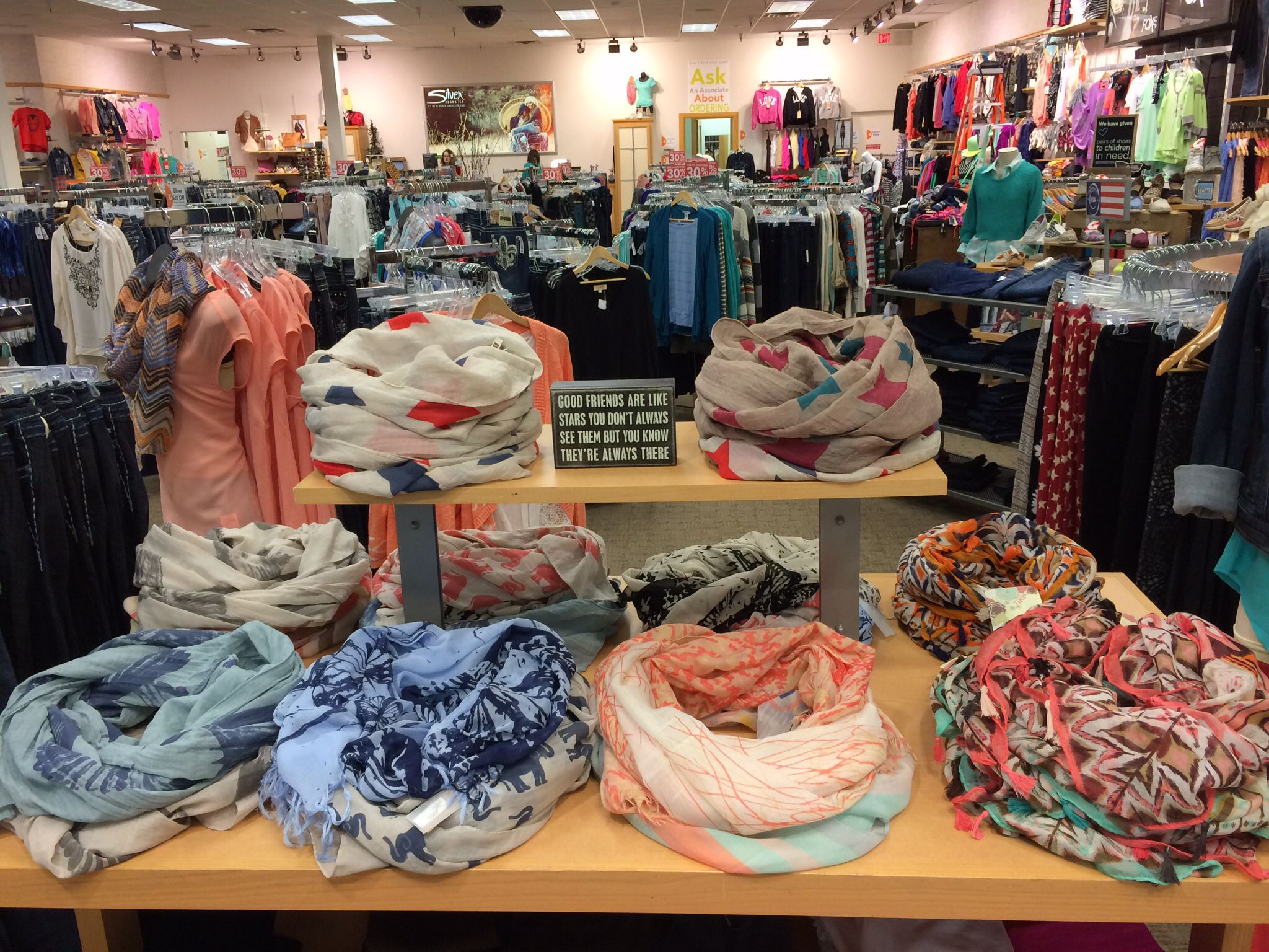 A new way to display infinity scarves. | Merchandising Inspiration ...