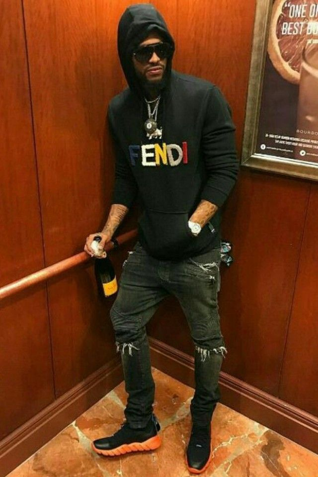 Dave East is wearing a logo hoodie and Runway sneakers b88096f27