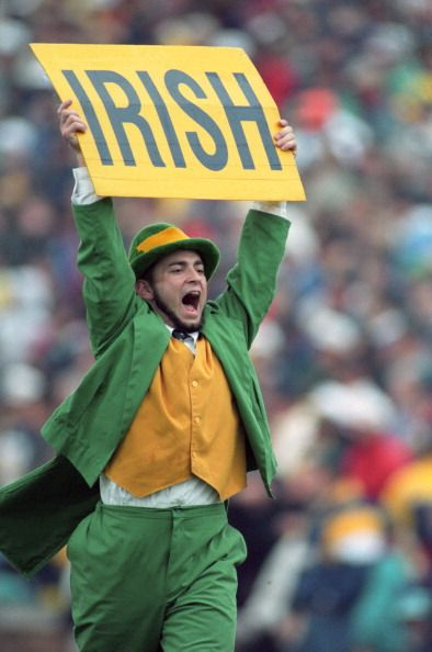 56d34de74 Notre Dame Fighting Irish mascot The Leprechaun mascot on field with ...