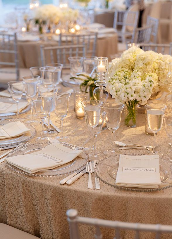 Beautiful all white centerpieces on cream color textured