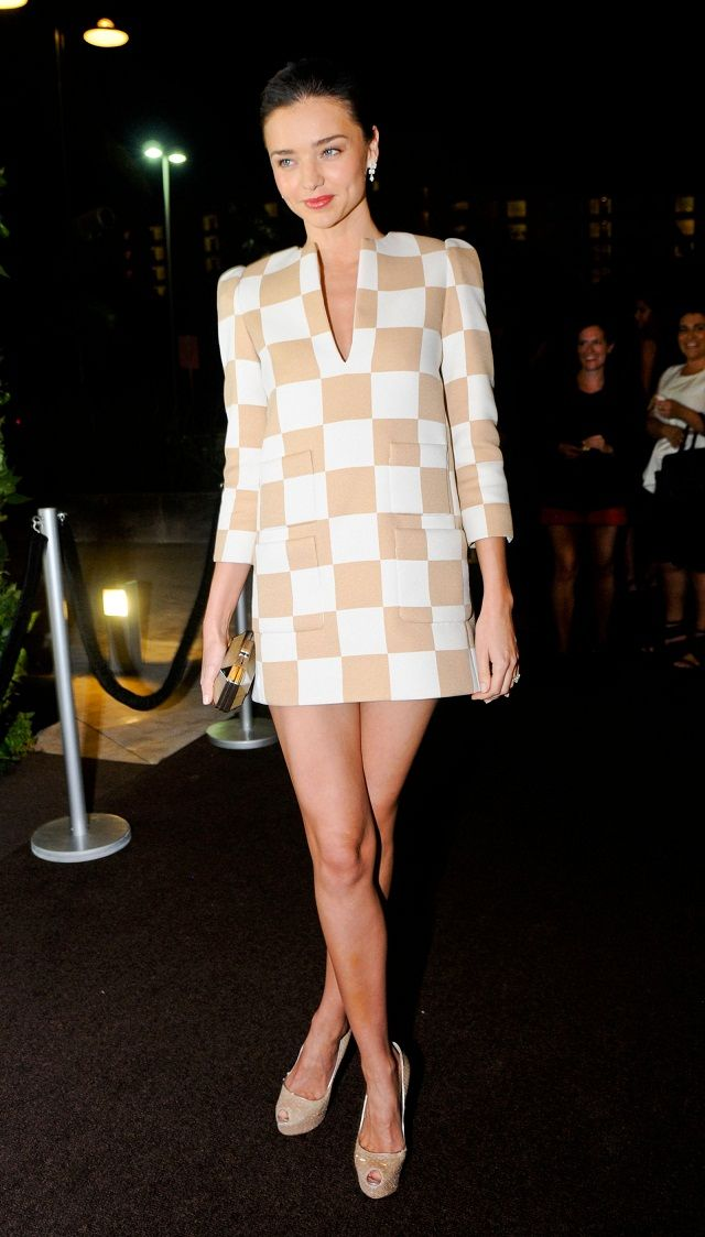 Miranda Kerr shows off legs at the Cancun opening of Louis Vuitton boutique