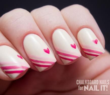 This Valentine's Day mani plays with a gradiant pink stripes for a romantic ombre effect. Nail It! uses ombre stripes, clean lines, and mini hearts for this lovely look.