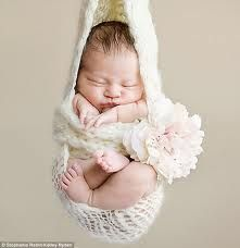 i just love these little baby pics...wish they were doing this when mine were itty bitty!