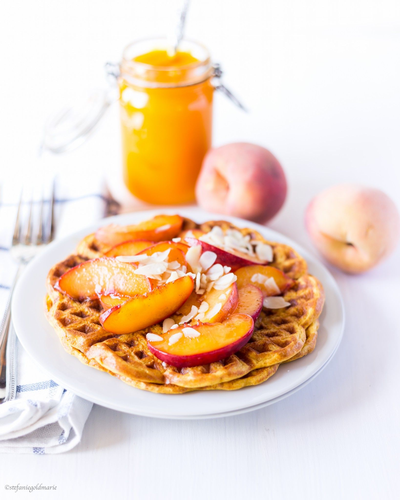 Delicious Pumpkin Spiced Waffles with caramelized Peaches. Healthy & Sugar Free