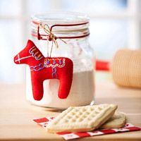 could make other things too.  Materials  Dala Horse Christmas Ornament  Enlarge Image        Transfer paper      Red felt      Embroidery hoop and needle      Embroidery floss: blue, yellow, and white      Polyester fiberfill      1/3 yard of 3/8-inch-wide satin ribbon: white