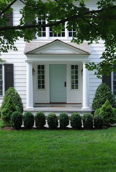 Front Seafoam Door And Small Bushes Outdoor Remodel House Exterior Architecture