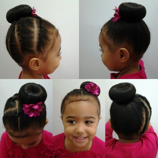Mixed girls hairstyles. Flat twist on one side and a bun on the next side