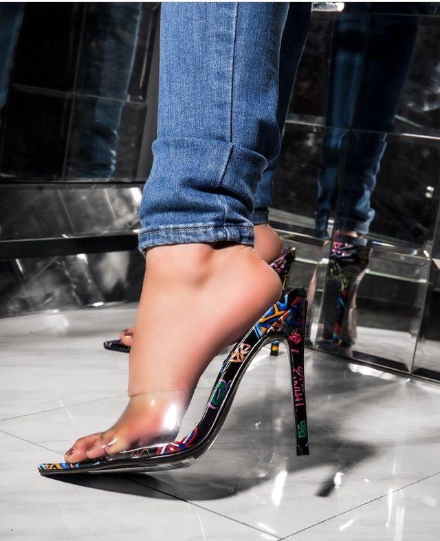 Clear slip on mule style heel with graffiti pattern bottom. Heel is approximately 4.5 inches.  #clearheels #sliponshoes #mules #muleshoes #highheels #shoeshighheels #shoesforwomen #shoesheels #heelsaddict #heels #stilleto #womenshoes #fashionista #womensfashion #stilettoheel
