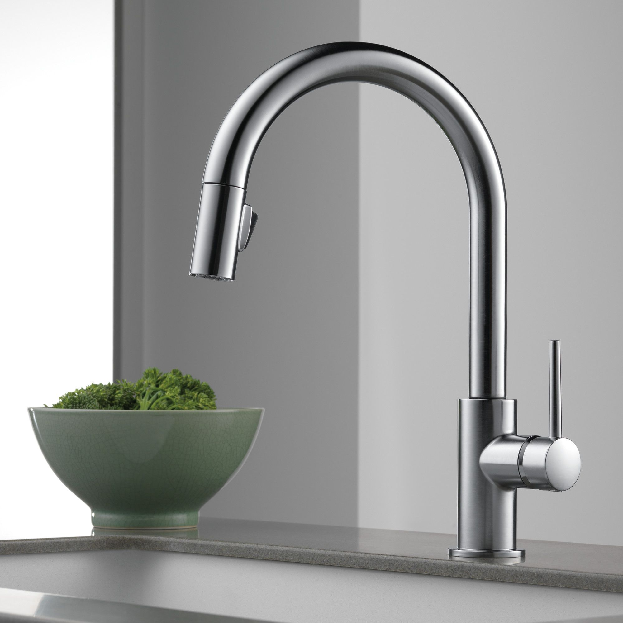 dst trinsic warranty stainless kitchen pull ar out faucet com includes delta arctic lifetime