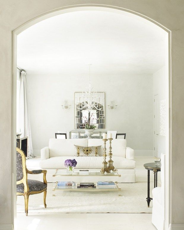 Sophisticated white Living Room by Houston-based interior designer and jewelry designer, Katie Scott, via @sarahsarna.