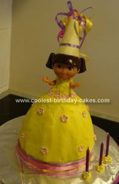 Homemade Dora Birthday Cake: My daughter wanted a Dora Birthday Cake, so I used a Dolly Varden cake pan and made a buttercake into this. I used a plastic Dora doll about 12cm big instead